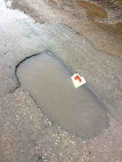 1 metre long, 7 cm deep pothole implicated in many tyre deaths. (Eleanor Rylance)