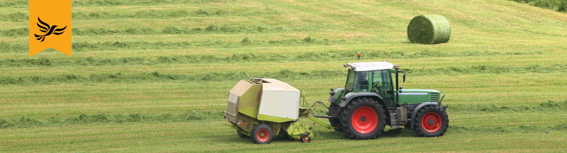 Tractor baling grass in Mid Devon